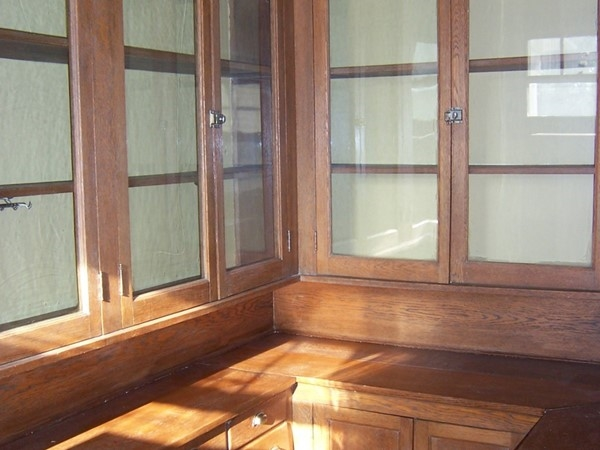 Original woodwork in the pantry of this large Park Avenue area home