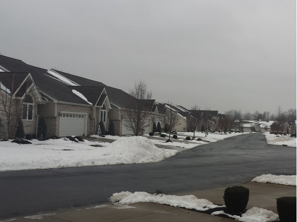 Street view of Townhomes on White Oak Terrace. Located in the Fairway Greens complex