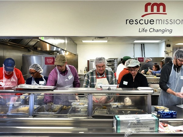 Volunteer workers packing 1700 take out dinners for needy families on Christmas morning