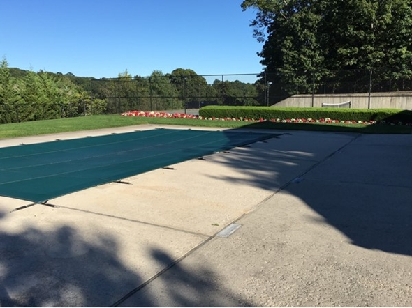 Pool and tennis courts at Harborview at Port Jefferson