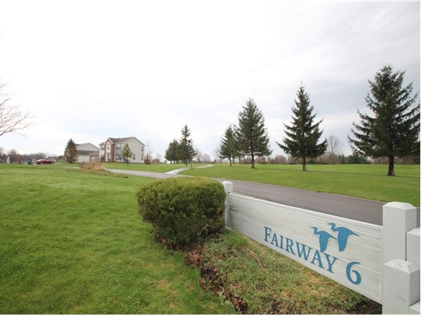 Residents of Gananda enjoy a backyard view of Fairway 6