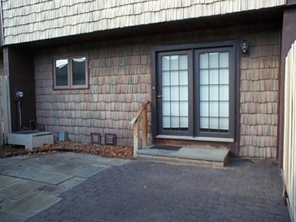 Patio between the back door and garage of the townhomes in Windsor Square in Penfield