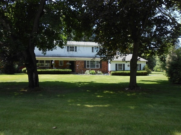Maple trees accent the yard of this Clifton Knolls colonial