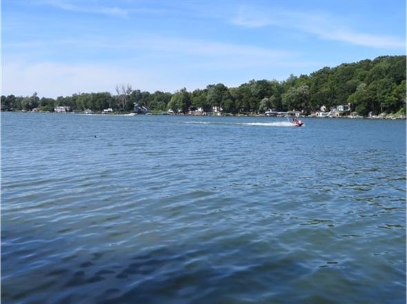 Water craft motoring on Port Bay
