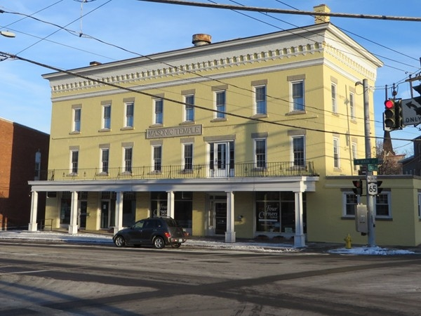Historic brick building at the four corners in Honeoye Falls