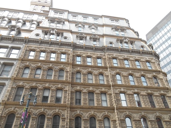 The Powers Building, built in the 1860's, was the first building in NY to have a passenger elevator
