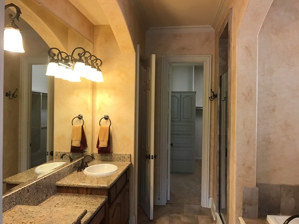Spacious master bath opens up to a huge closet in the back