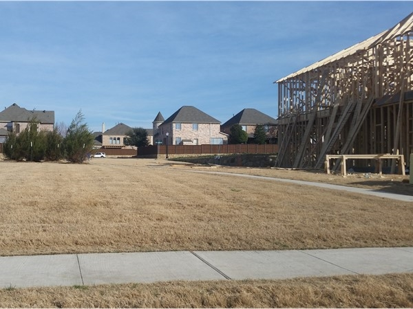 Part of the walking paths in The Park with new construction homes in South Plano