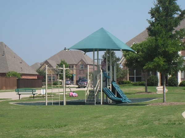 The play area by the pool in Crown Ridge is a popular place